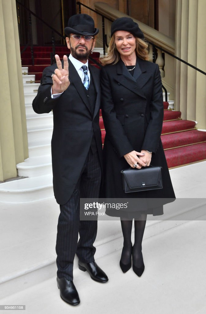 Ringo Starr, real name Richard Starkey, poses with his wife Barbara Bach as he arrives at Buckingham Palace to receive his Knighthood at an Investiture ceremony on March 20, 2018 in London, England.