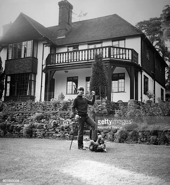 Ringo Starr relaxes on the lawn of his Weybridge mansion with his two dogs in Weybridge United Kingdom circa 1960
