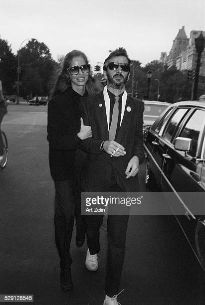 Ringo Starr with Barbara Bach his wife walking on the street circa 1970 New York