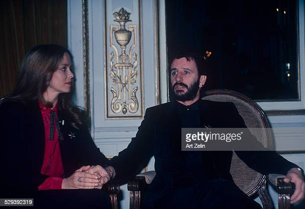 Ringo Starr with his wife Barbara Bach miked for an interview They are holding hands circa 1970 New York