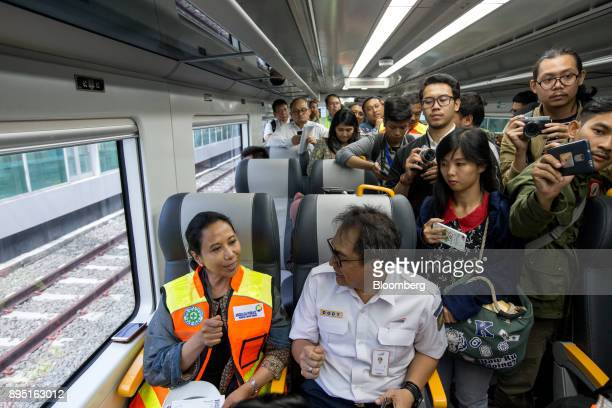 Rini Soemarno Indonesia's minister of stateowned enterprises left takes a seat on the SoekarnoHatta International Airport Rail Link operated by PT...