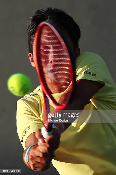 Rinky Hijikata of Australia serves in his first round Junior Boys Doubles match with Otto Virtanen of Finland against Stefan Storch of Australia and...