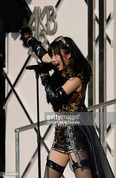 Rino Sashihara member of Japanese girl pop group AKB48 performs during their concert at the Yokohama stadium in Yokohama south of Tokyo on June 8...