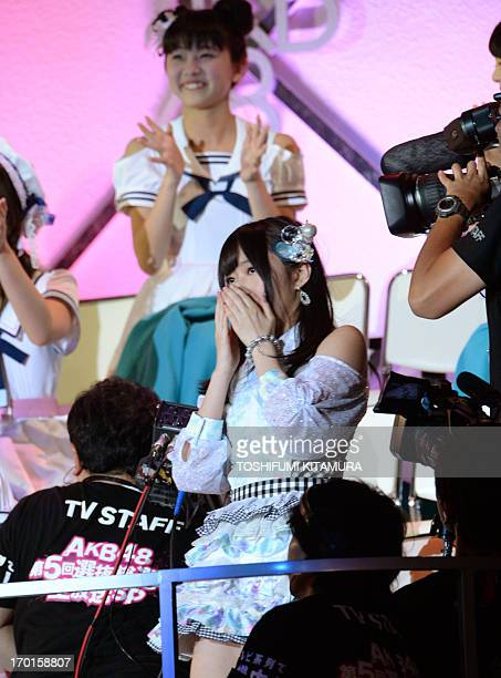Rino Sashihara of HKT48 one from a Japanese pop group AKB48 reacts after being selected as the centre position for the upcoming recording members...