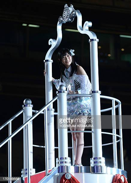 Rino Sashihara of HKT48 one part of Japanese girl pop group AKB48 acknowledges fans after she was selected for the first and centre recording...