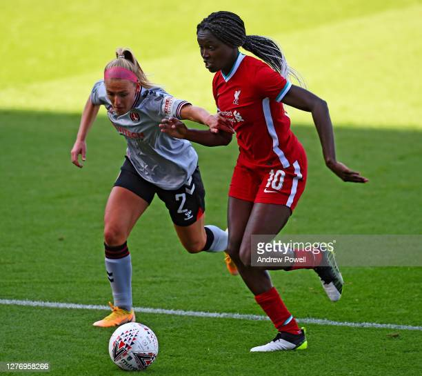 Rinsola Babajide of Liverpool Women with Rachel Newborough of Charlton Athletic Women during the FA Women's Championship match between Liverpool...