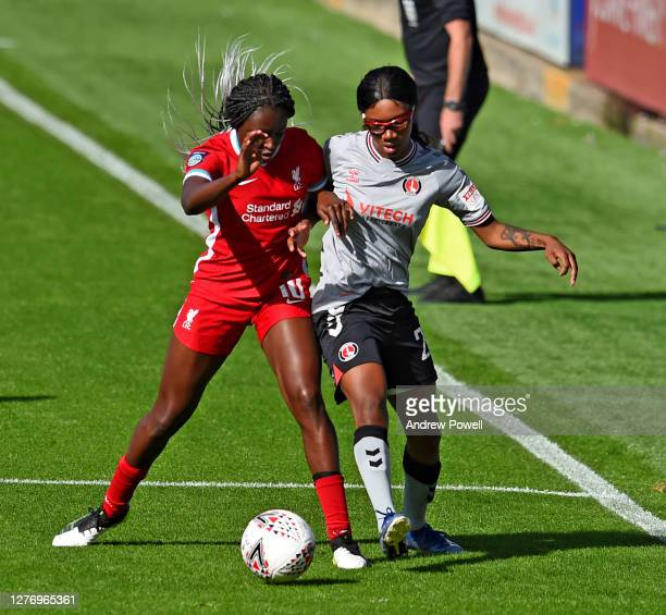 Rinsola Babajide of Liverpool Women with Shauna Vassell of Charlton Athletic Women during the FA Women's Championship match between Liverpool Women...