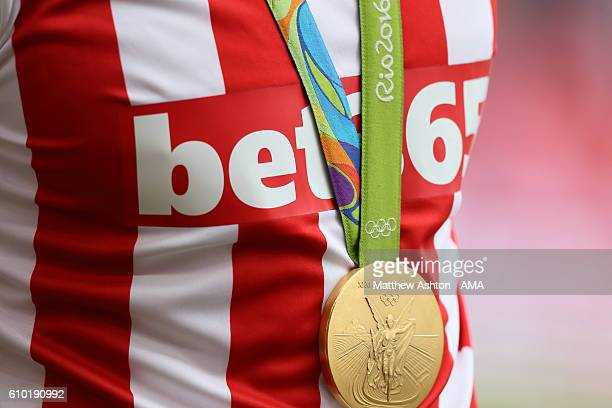Rio 2016 Paralympic gold medal around the neck of Stoke City fan Joe Clarke in the Men's kayak single during the Premier League match between Stoke...