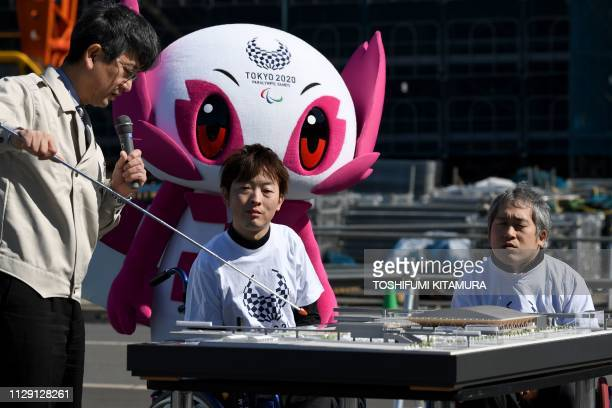 Rio 2016 Paralympics Boccia silver medalists Hidetaka Sugimura and Takayuki Hirose and Tokyo 2020 Paralympic mascot Someity listen to Tokyo 2020...