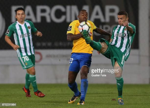 Rio Ave FC defender Lionn from Brazil with GD Estoril Praia forward Victor Andrade from Brazil in action during the Primeira Liga match between GD...
