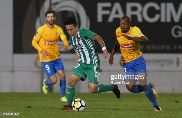 Rio Ave FC forward Oscar Barreto from Colombia with GD Estoril Praia forward Victor Andrade from Brazil in action during the Primeira Liga match...