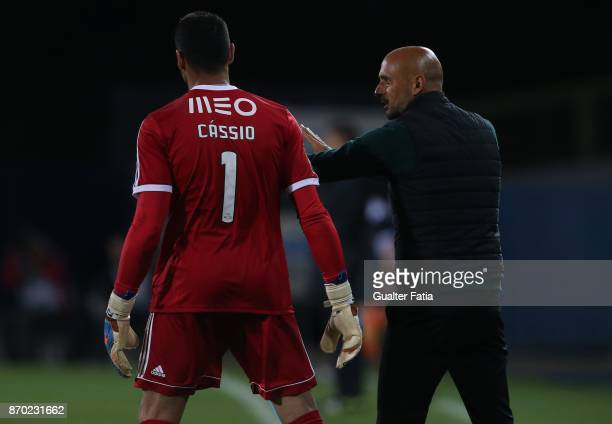 Rio Ave FC head coach Miguel Cardoso from Portugal talks with Rio Ave FC goalkeeper Cassio from Brazil during the Primeira Liga match between GD...