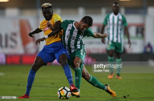 Rio Ave FC midfielder Joao Novais from Portugal with GD Estoril Praia forward Allano Lima from Brazil in action during the Primeira Liga match...