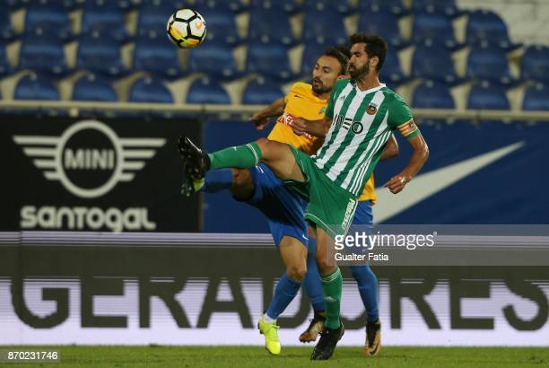 Rio Ave FC midfielder Tarantini from Portugal with GD Estoril Praia forward Andre Claro from Portugal in action during the Primeira Liga match...