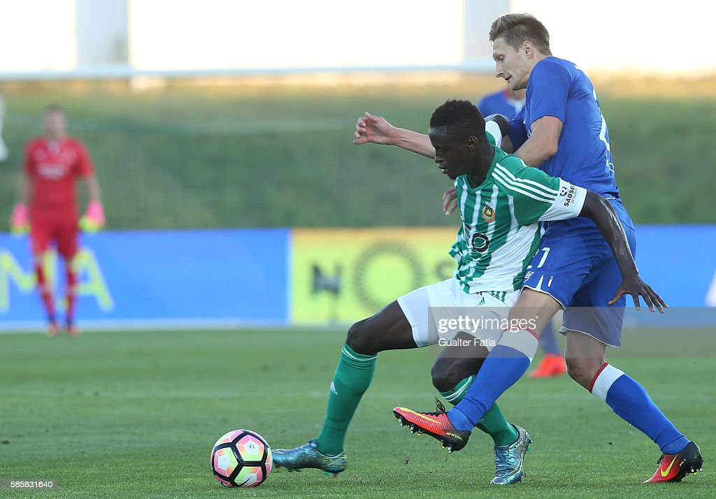 Rio Ave FC's defender Eliseu Cassama with Slavia Praha's forward Milan Skoda in action during the UEFA Europa League Qualifications Semi-Finals 2nd Leg match between Rio Ave FC and Slavia Praha at Estadio dos Arcos on August 4, 2016 in Povoa de Varzim, Portugal.