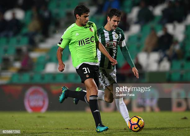 Rio Ave FC's forward Gil Dias with Vitoria de Setubal's defender Frederico Venancio in action during Primeira Liga match between Vitoria Setubal and...
