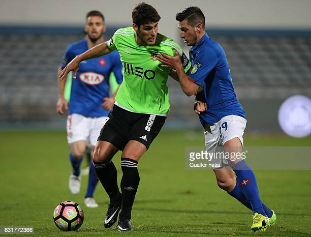 Rio Ave FC's forward Goncalo Paciencia with Belenenses's defender Florent Hanin from France in action during the Primeira Liga match between CF Os...