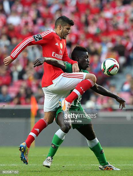 Rio Ave FC's forward Yazalde with SL Benfica's defender Lisandro Lopez in action during the Primeira Liga match between SL Benfica and Rio Ave FC at...