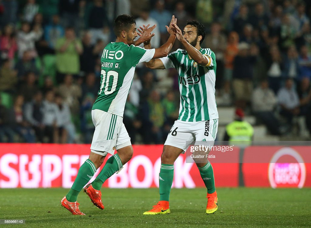 Rio Ave FC's midfielder Ruben Ribeiro (L) celebrates with teammate Rio Ave FC's defender Marcelo (R) after scoring a goal during the UEFA Europa League Qualifications Semi-Finals 2nd Leg match between Rio Ave FC and Slavia Praha at Estadio dos Arcos on August 4, 2016 in Povoa de Varzim, Portugal.