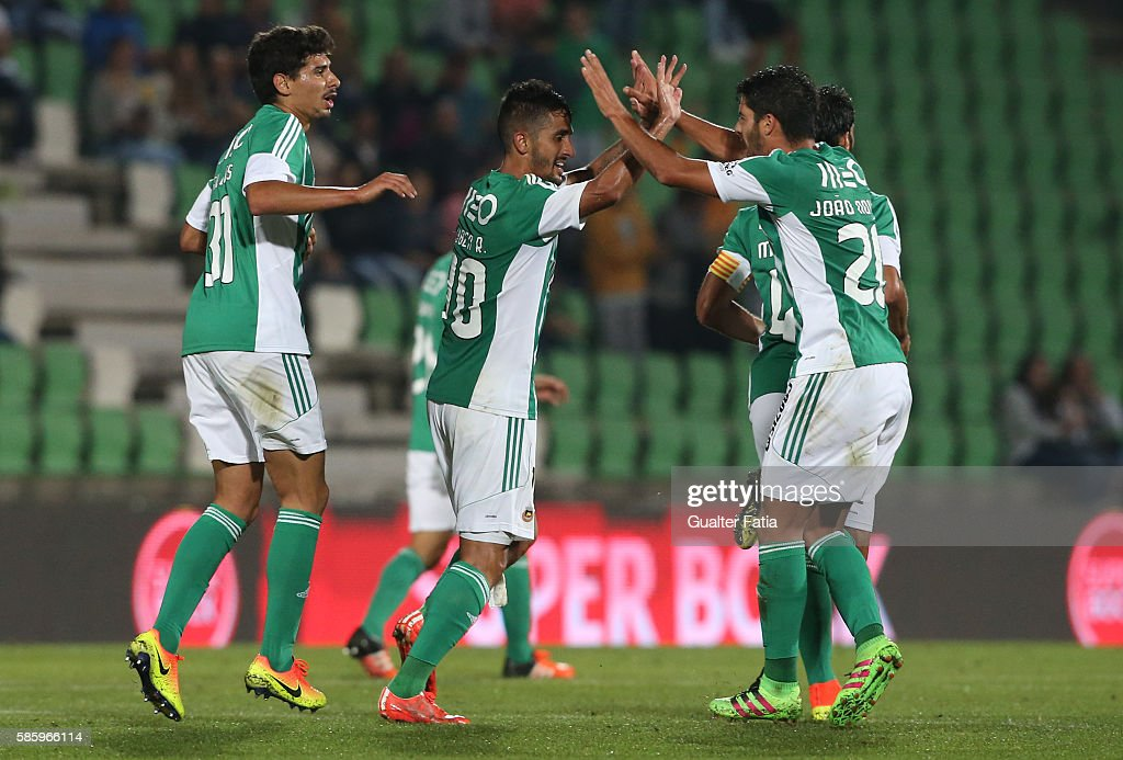 Rio Ave FC's midfielder Ruben Ribeiro celebrates with teammates after scoring a goal during the UEFA Europa League Qualifications Semi-Finals 2nd Leg match between Rio Ave FC and Slavia Praha at Estadio dos Arcos on August 4, 2016 in Povoa de Varzim, Portugal.