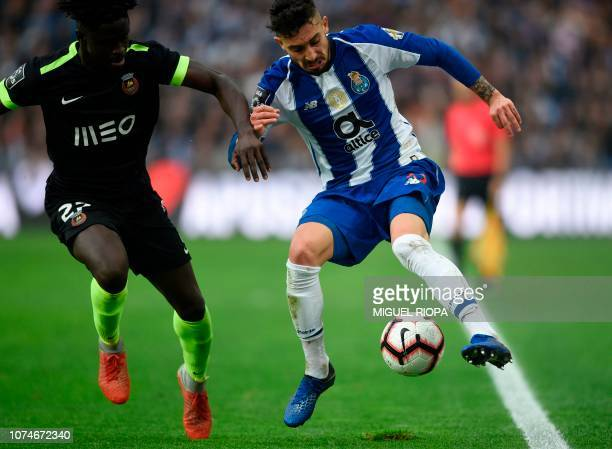 Rio Ave's BissauGuinean defender Eliseu Nadjack challenges Porto's Brazilian defender Alex Telles during the Portuguese League football match between...