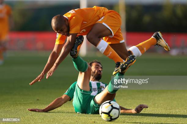 Rio Ave´s Brazilian defender Marcelo with Porto's Algerian forward Yacine Brahimi during the Premier League 2017/18 match between Rio Ave FC and FC...