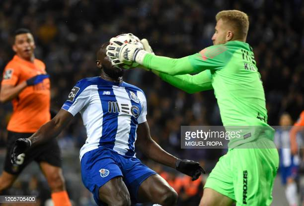 Rio Ave's Polish goalkeeper Pawel Kieszek catches the ball next to FC Porto's Malian forward Moussa Marega during the Portuguese league football...