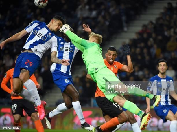 Rio Ave's Polish goalkeeper Pawel Kieszek jumps for a ball with FC Porto's Brazilian forward Tiquinho during the Portuguese league football match...