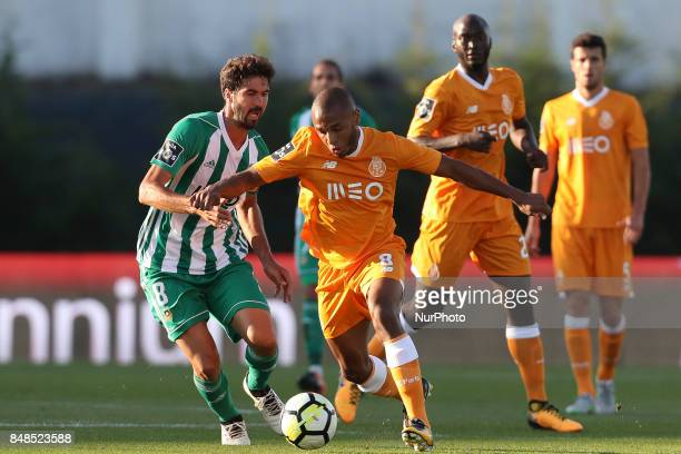 Rio Ave´s Portuguese midfielder Tarantino with Porto's Algerian forward Yacine Brahimi during the Premier League 2017/18 match between Rio Ave FC and...