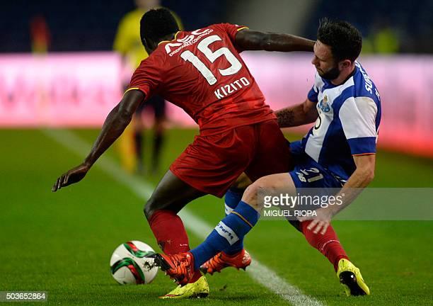 Rio Ave's Ugandan midfielder Luwagga Kizito vies with Porto's Mexican defender Miguel Layun during the Portuguese league football match FC Porto vs...