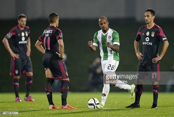 Rio Ave's Venezuelan forward Yonathan Del Valle celebrates after scoring a goal next to Benfica's Brazilian forward Rodrigo Lima and teammate...
