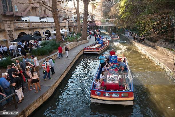 rio boat tour - san antonio river walk stock photos and pictures