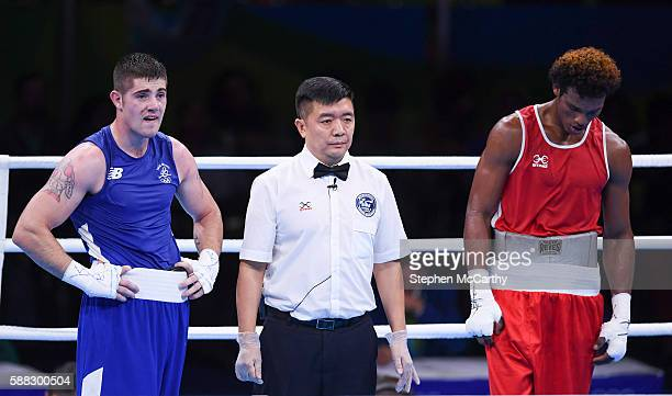 Rio Brazil 10 August 2016 Joe Ward of Ireland left and Carlos Andres Mina of Ecuador await the judges decision during their LightHeavyweight...