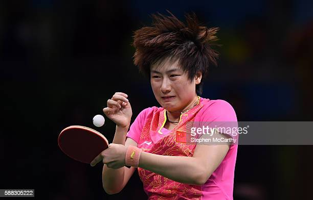 Rio Brazil 10 August 2016 Ning Ding of China competes in the Women's Single's Gold Medal Match between Ning Ding of China and Xiaoxia Li of China in...