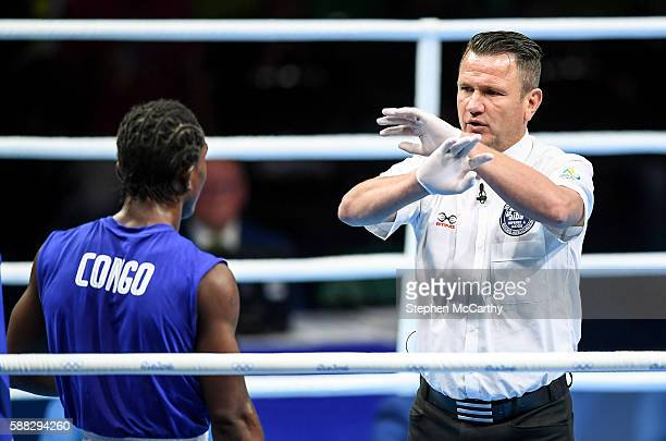 Rio Brazil 10 August 2016 The referee signals to Dival Forele Malonga Dzalamou of Congo that the fight is over resulting in a TKO win for Fazliddin...
