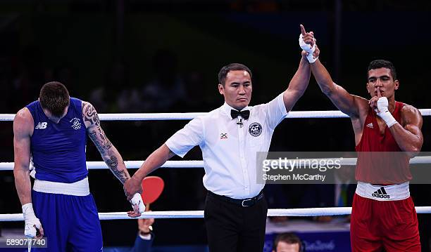 Rio Brazil 13 August 2016 Mohammed Rabii of Morocco is declared victorious over Steven Donnelly of Ireland during their Welterweight preliminary...
