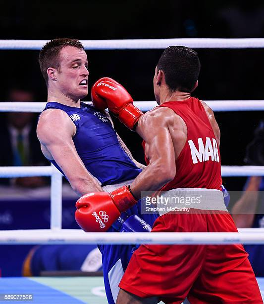 Rio Brazil 13 August 2016 Steven Donnelly of Ireland left in action against Mohammed Rabii of Morocco during their Welterweight preliminary round of...