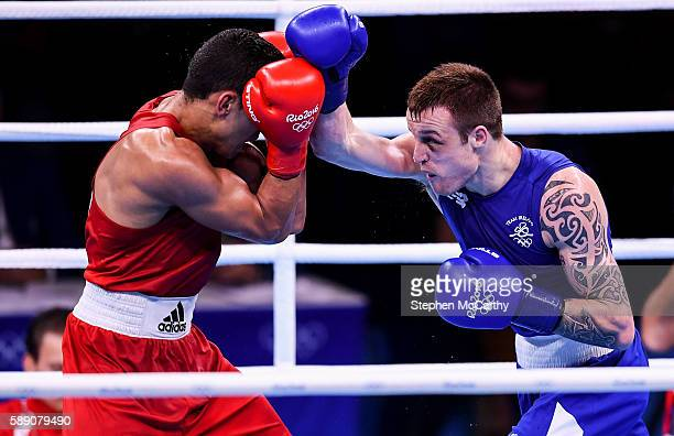 Rio Brazil 13 August 2016 Steven Donnelly of Ireland right in action against Mohammed Rabii of Morocco during their Welterweight preliminary round of...