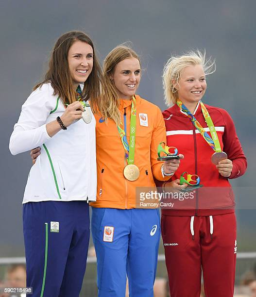 Rio Brazil 16 August 2016 Annalise Murphy of Ireland on the podium with her silver medal along with Marit Bouwmeester of the Netherlands who won gold...