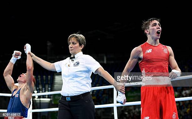 Rio Brazil 16 August 2016 Vladimir Nikitin of Russia is declared victorious over Michael Conlan of Ireland during their Bantamweight Quarter final...