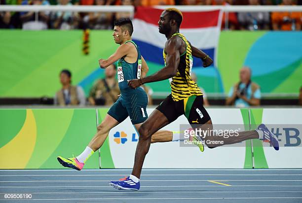 Rio Brazil 17 September 2016 Petrucio Ferreira dos Santos of Brazil left and Shane Hudson of Jamaica in action during the Men's 400m T47 Final at the...