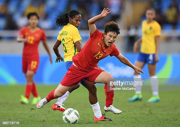 Rio Brazil 3 August 2016 Fengyue Pang of China in action against Formiga of Brazil during the Women's Football first round Group E match between...