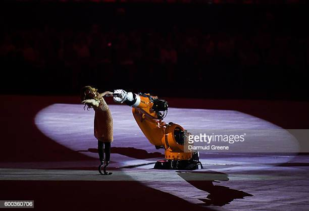 Rio Brazil 7 September 2016 Actress model worldclass snowboarder and 2014 Paralympic bronze medalist Amy Purdy performs with Kuka the Robot during...