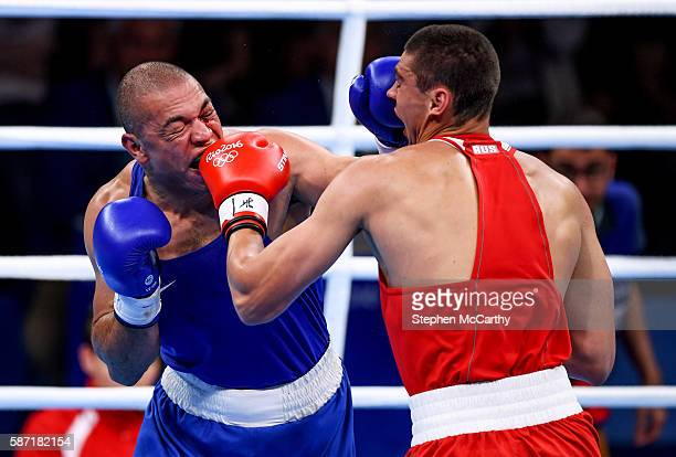 Rio Brazil 8 August 2016 Juan Nogueeira of Brazil left and Evgeny Tishchenko of Russia during their Heavyweight preliminary round of 32 bout in the...