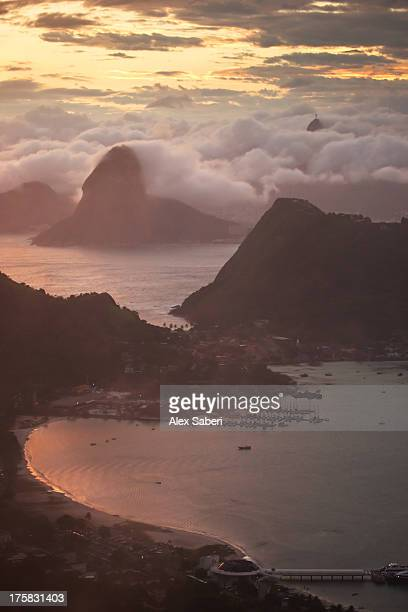 rio de janeiro at sunset with sugar loaf and christ the redeemer from niteroi. - alex saberi stock pictures, royalty-free photos & images