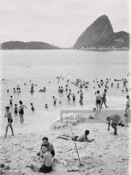 Bathers enjoy sun and surf at Flamengo Bay Beach
