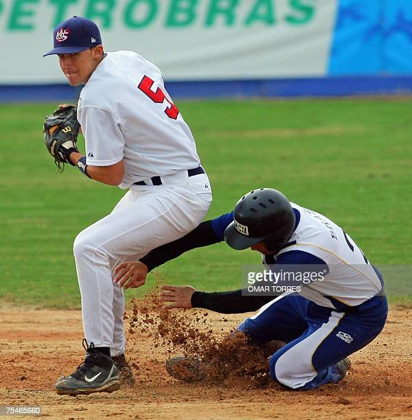 Brazilian third base Ronaldo Ono slides in second base as US Ryan Flaherty prepares to throws to double play at the fifth inning of the preliminary...