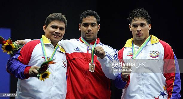 Bronze medallist Venezuelan Octavio Mejia Gold medallist Cuban Ivan Cambar and Silver medallist Venezuelan Jose Ocando pose at the podium after the...