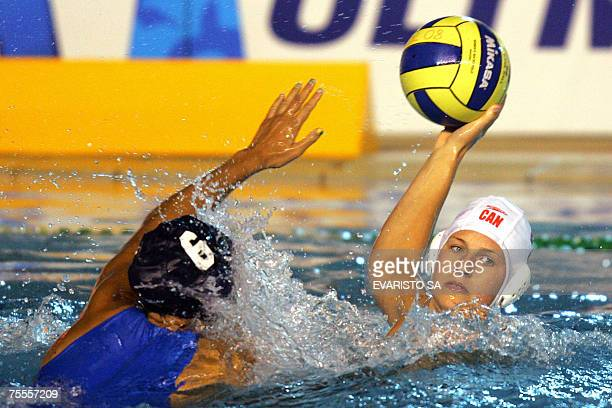 Canadian player Emily Csikos shoots the ball as Brazilian player Cecilia Canetti tries a block during the women's waterpolo semifinal match at the...