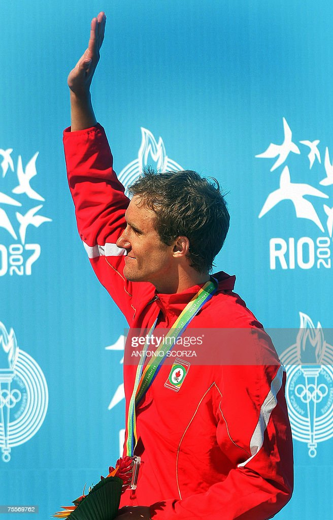 Canadian swimmer Adam Sioui acknowledges to people during the 200m Freestyle Bronze Medal podium ceremony, 20 July 2007, at the Pan American games in Rio de Janeiro, Brazil. AFP PHOTO ANTONIO